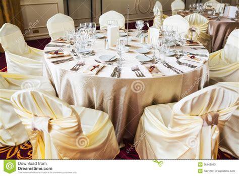 Beige Wedding Decor - indoor wedding table with beige decoration stock image