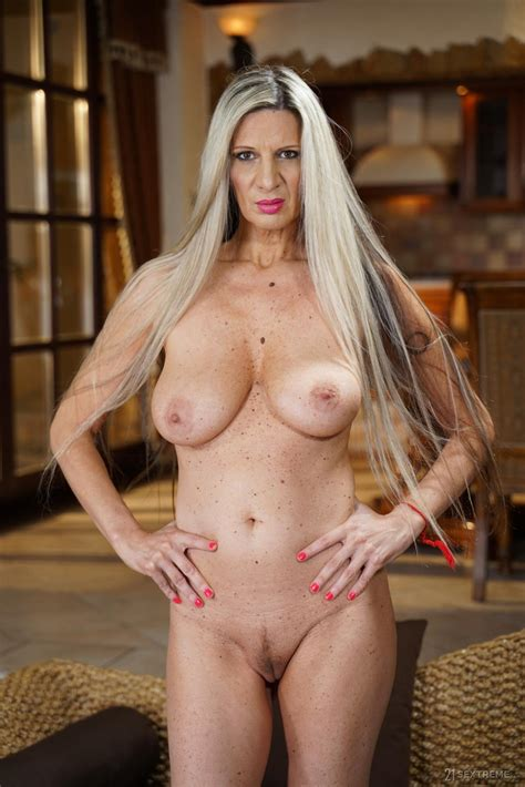 Long Haired Mature With Big Natural Tits Sucks Young