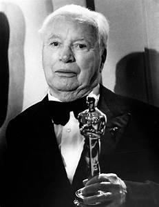 Charles Chaplin holds his Honorary Oscar. April, 1972 ...