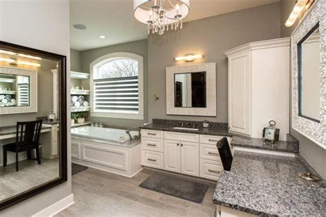 white cabinets gray walls drop  tub caledonia granite