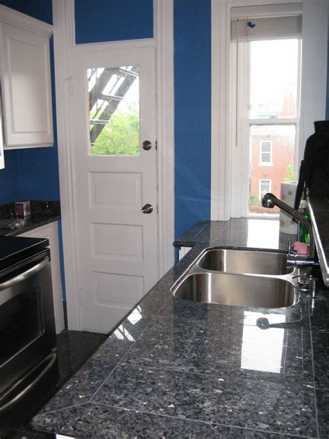 best ideas about blue pearl granite blue countertops beige cabinets and