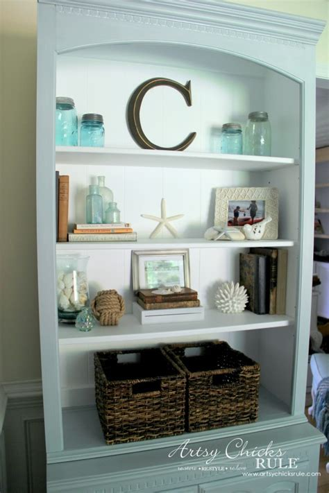 Decorating Bookshelves With Baskets by Coastal Styled Bookshelves How To Style Shelves Artsy