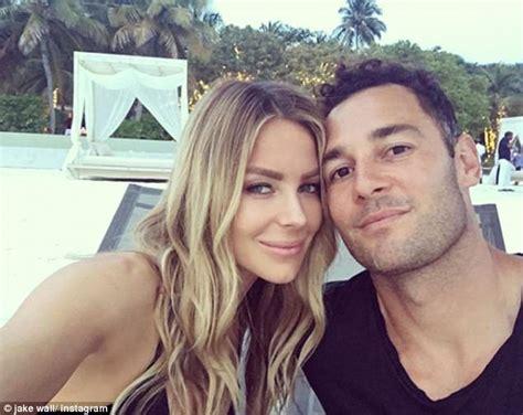 Jennifer Hawkins Cuddles Up To Husband Jake Wall