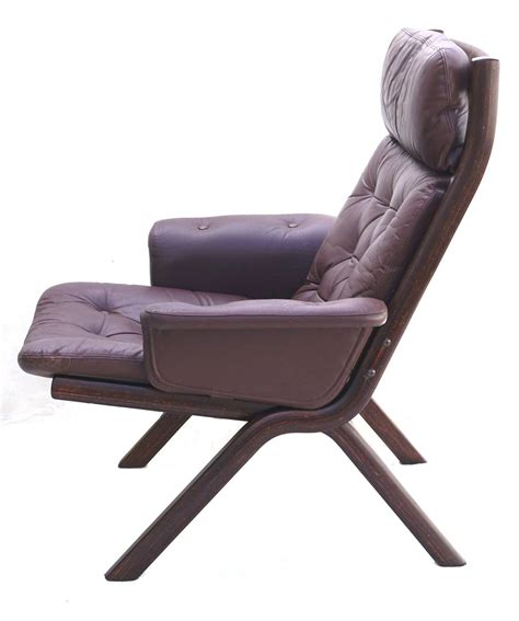 modern leather sculptural sling lounge chair and