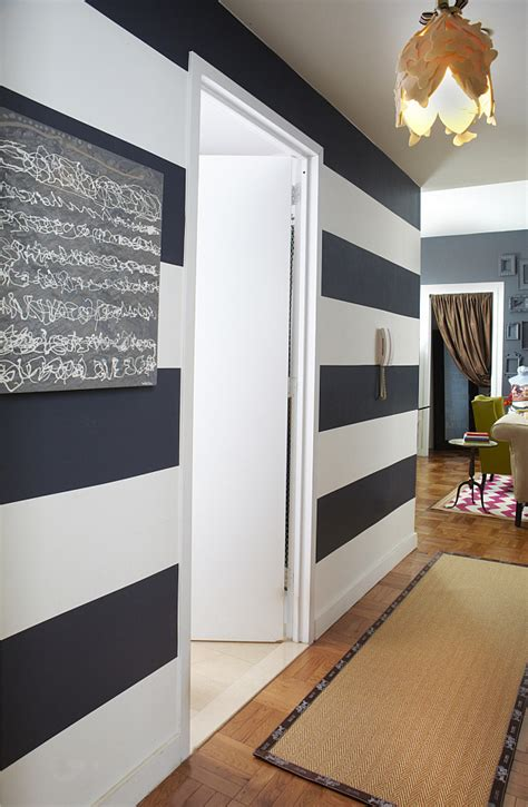 black and white striped wall how to design a small rental apartment by janet lee