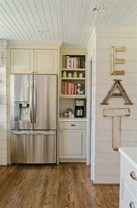 Kitchen With Beadboard Ceiling And Paneled Walls