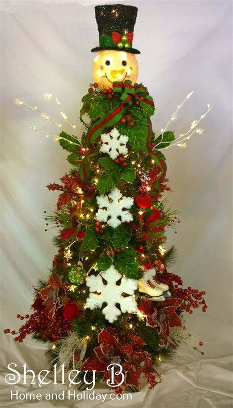 snowman head topper decorated christmas tree