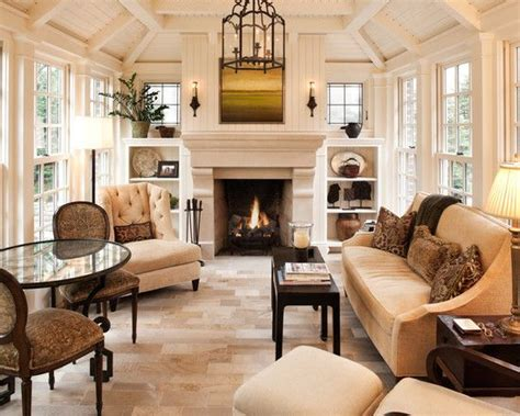 airy yet cozy living room with limestone fireplace flanked