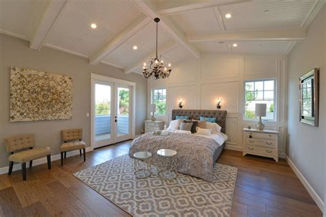 traditional master bedroom with carpet cathedral ceiling