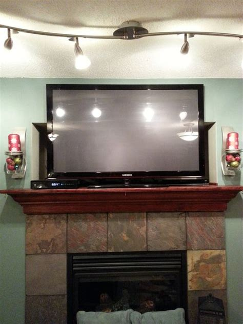 Hang Tv Above Brick Fireplace by Drywall How Do I Mount A Tv To Cover A Cubby Hole Above