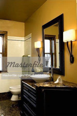 bathroom bright mustard colored walls brown granite