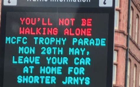 photo liverpool fans trolled  manchester traffic sign