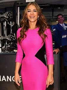Elizabeth Hurley flashes VERY ample assets as she shares ...