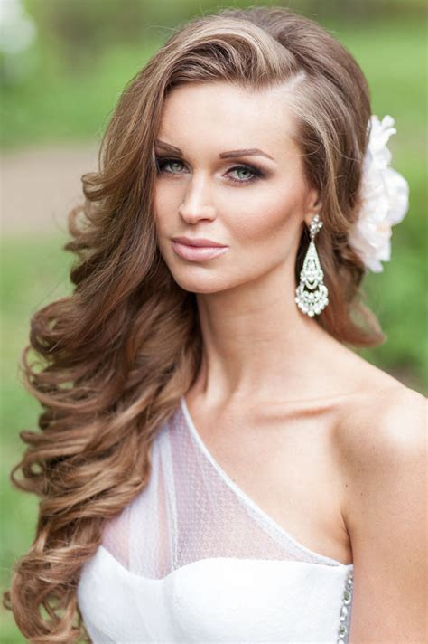 one side half up wavy wedding hairstyle with flower deer