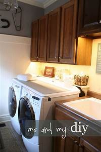 Laundry room makeover hanging baskets washers and cabinets for Under cabinet washer and dryer