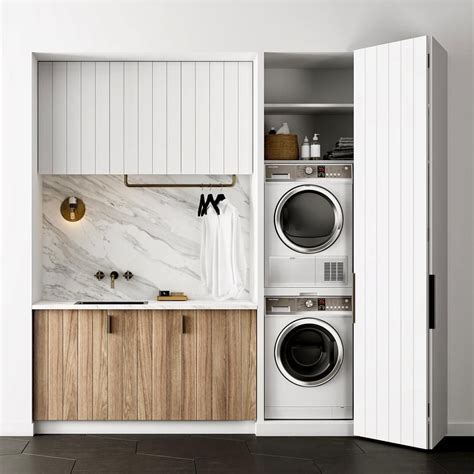 Laundry Cupboard Doors by Micro Laundry With Black Tiles And Marble Countertop Our