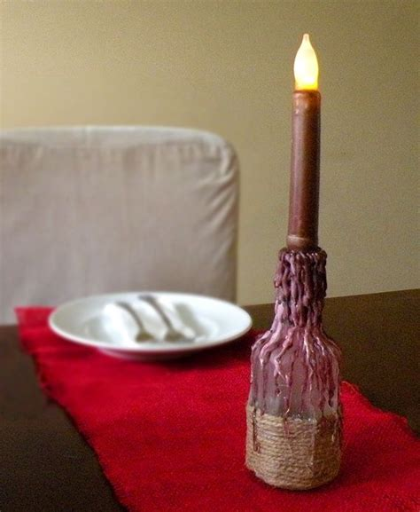 diy faux wax dripped bottle candle holder bottle candles