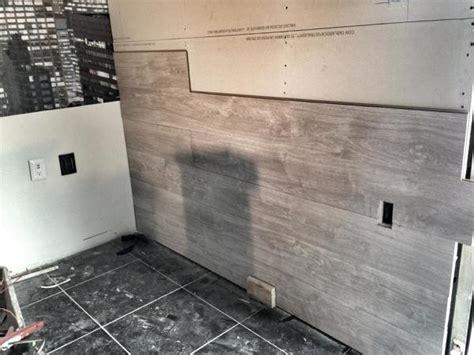 foto colocacion de piso laminado en muro de admas