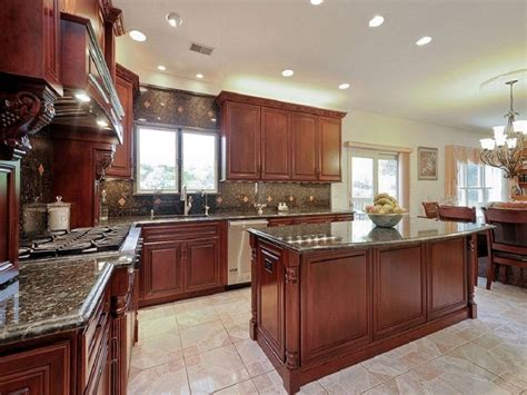 Select a light color, such as a taupe, ivory or light gray, that offsets the shade of the cherry wood. 25 Cherry Wood Kitchens (Cabinet Designs & Ideas ...