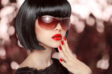 Fashion Brunette Woman In Sunglasses. Black Bob Hairstyle