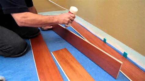 lay floating floor how to install a hardwood floating floor youtube