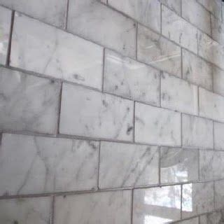 white carrera marble  gray grout kitchen