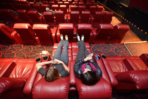 theatre with reclining seats amc theaters lure moviegoers with cushy recliners the