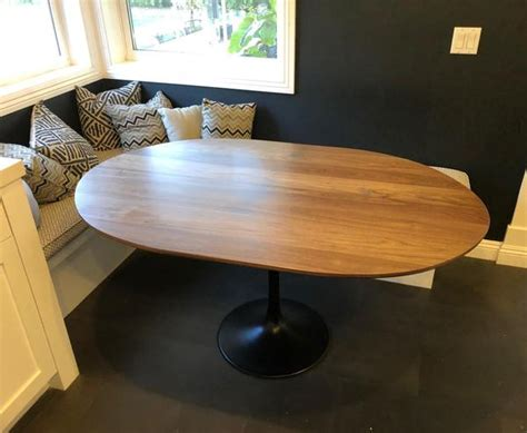 oval tulip base kitchen dining table  walnut top