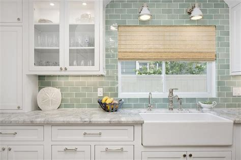 sconce over kitchen sink white and green kitchen with farmhouse sink transitional