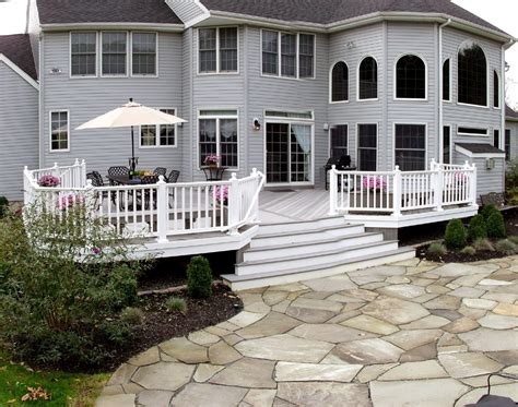 flagstone paver patio leads   maintenance deck