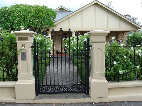 gate pillars for residential homes rendered brick pillars and fence with iron work gate and fence panels mexico house pinterest