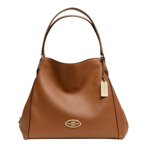 coach edie shoulder bag  brown lyst