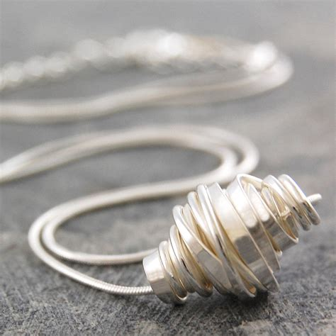 coiled sterling silver jewellery set by otis jaxon silver