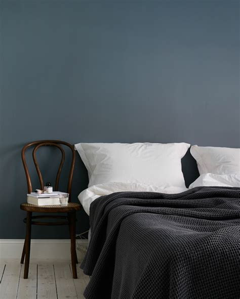 how to decorate with blue walls decordots simple bedroom design dark blue wall and warm brown wood