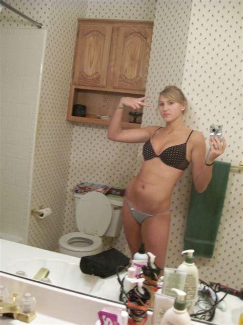 a girl a camera and a mirror 42 photos
