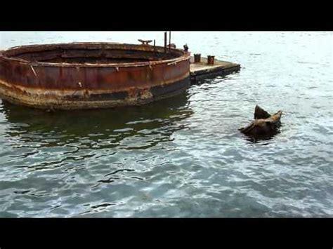 uss arizona  leaking oil pearl harbor hawaii