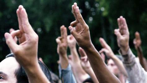 what does the hunger sign thailand protestors using salute from the hunger games