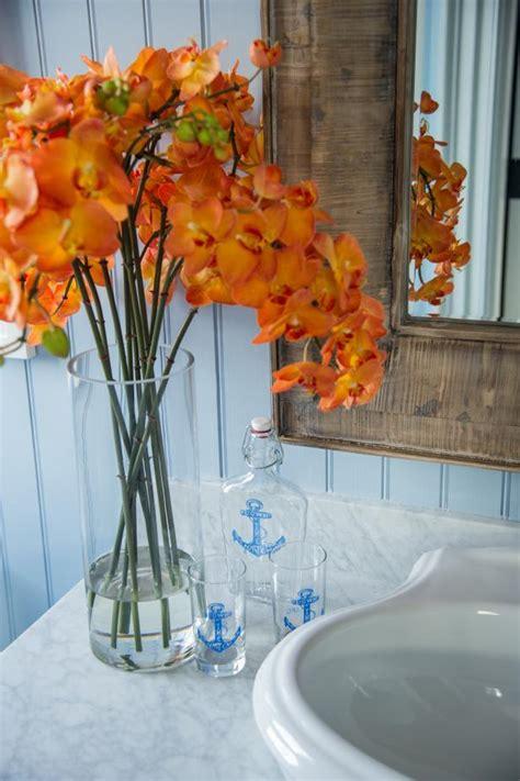 orange flowers  guest bathroom counter hgtv
