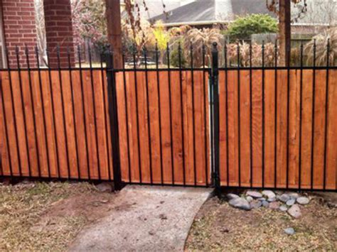 wrought iron and wood fence we build iron fences wrought iron gates in the woodlands texas