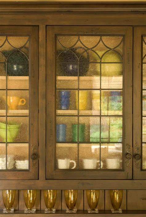 leaded glass for kitchen cabinets kitchen cabinets with furniture style flair traditional home 8927