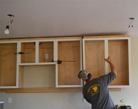 easy way to hang cabinets installing kitchen cabinets momplex vanilla kitchen