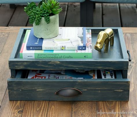 One of the ideas is to put a tray on your coffee table. Coffee Table Tray with Drawer {Lowes Creative Idea} - Infarrantly Creative