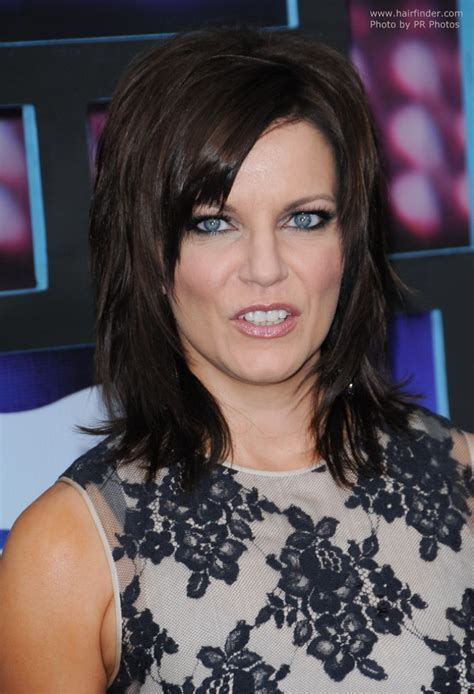 Martina McBride wearing her hair in a long layered ****