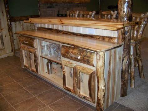 hand crafted custom refinished basement  log bar bar stools  wood work  irelands wood
