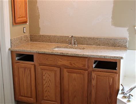 black granite with oak kitchen cabinets brown hairs