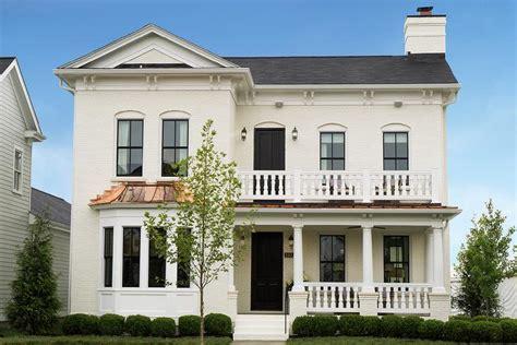 Cream Brick Home Exteriors With Black Door  Transitional
