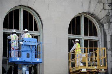 believing workers remove asbestos  michigan