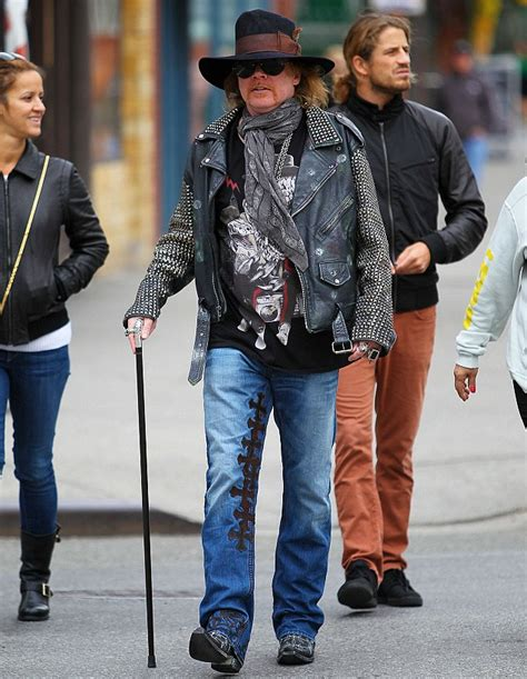 axl rose u2 one axl rose brandishes a walking cane as he steps out in his