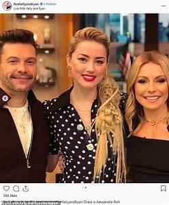 Amber Heard looks chic in a navy polka dot dress following ...