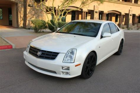 buy   cadillac sts  pearl white brand